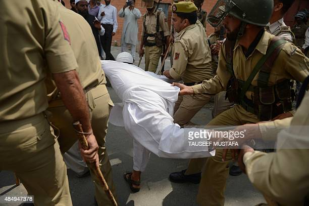 Indian police try to detain supporters of the hardline faction of the All Parties Hurriyat Confrence as they clash during a protest following the...