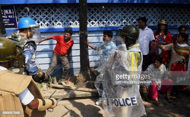 Indian police try to disperse Leftist demonstrators during a march towards the state secretariat in Kolkata on May 22 2017 Demonstrators and police...