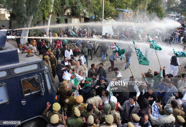 Indian police use water canons against supporters of Kashmir's Peoples Democratic Party as they take part in an antigovernment protest in Jammu on...
