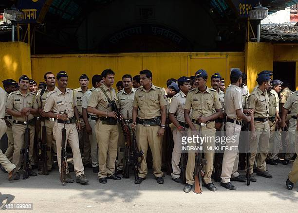 Indian police wait to escort men convicted over their involvement in the 2006 commuter train blasts next to a prison in Mumbai on September 14 2015...