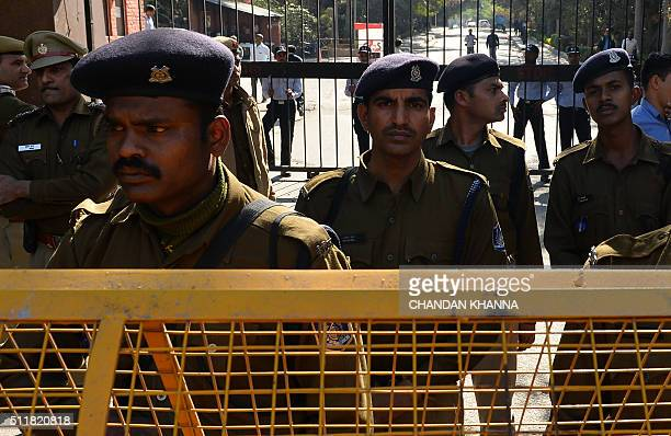 Indian police watch a protest in support of a student accused of sedition outside Jawaharlal Nehru University in New Delhi on February 23 2016 Indian...