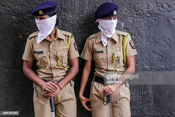 Indian police woman stand guard in Nashik Maharashtra India on Sunday Sept 13 2015 Millions of pilgrims in a landscape awash in saffron make their...
