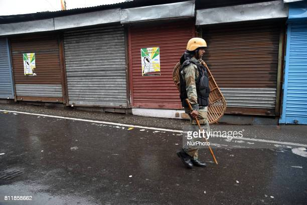 Indian policeman during the Gorkha Janmukti Morcha strike on 9 July 2017 in Darjeeling India Eastern India's hill resort of Darjeeling has been...
