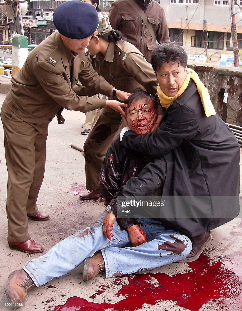 Indian Policemen and a supporter assist the President of the Akhil Bharatiya Gorkha League (ABGL), Madan Tamang after he was repeatedly stabbed with swords and kukris in Darjeeling on May 21,2010. Tension gripped the eastern Indian hill town of Darjeeling with the murder of a separatist leader campaigning for a new state for ethnic Nepalese speakers, police said. Security in the tea-growing region in West Bengal was stepped up after Madan Tamang, president of the All India Gorkha League, was fatally stabbed as he was about to address a public meeting.