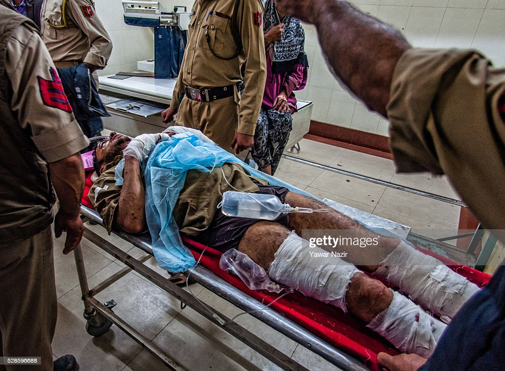 Indian policemen and paramedics carry a wounded Indian policeman on to a gurney inside a hospital after a grenade attack by suspected militants on May 05, 2016 in Srinagar, the summer capital of Indian administered Kashmir, India. Every year thousands of Muslim devotees from across Kashmir throng the Hazratbal shrine in central Srinagar for prayers and to have a glimpse of the Moi-e-Muqaddas, Holy Relic of Prophet Mohammed, displayed for public viewing on ten occasions in a year , including Meraj-ul Alam , the night Muslims believe Prophet Mohammed ascended to the heaven.