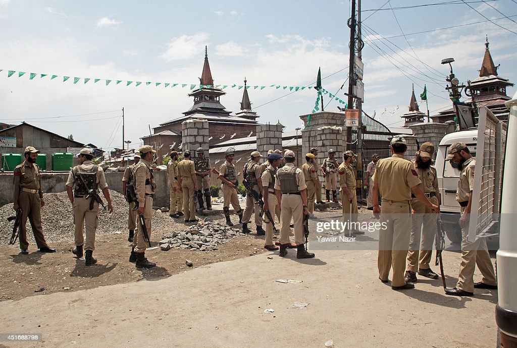 Indian policemen and paramilitary soldiers stand guard in the Old City during a strike against Indian Prime Minister Narendra Modi's visit on July 4, 2014, in Srinagar,the summer capital of Indian administered Kashmir, India. India's newly elected leader, Prime Minister Narendra Modi made his first official trip to Indian-controlled Kashmir, India's only Muslim-majority state, where separatist groups called a strike that closed down shops, businesses, schools, and all traffic. Disputes arose from Prime Minister Narendra Modi's inauguration of a railway line and a plan to review security and development in the Himalayan region dividing India and Pakistan. Reports stated that the restrictions were imposed to prevent any violent protests by separatist groups who oppose Indian rule.