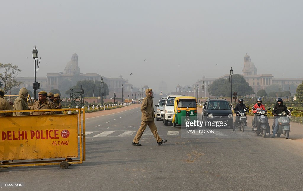 Indian policemen are pictured at a road leading towards the Government Secretariat, the scene of violent protests against the gang rape of a student who succumbed to her injuries early December 29, in New Delhi on December 31, 2012. The family of an Indian gang-rape victim said they would not rest until her killers are hanged as they spoke of their own pain and trauma over a crime that has united the country in grief.
