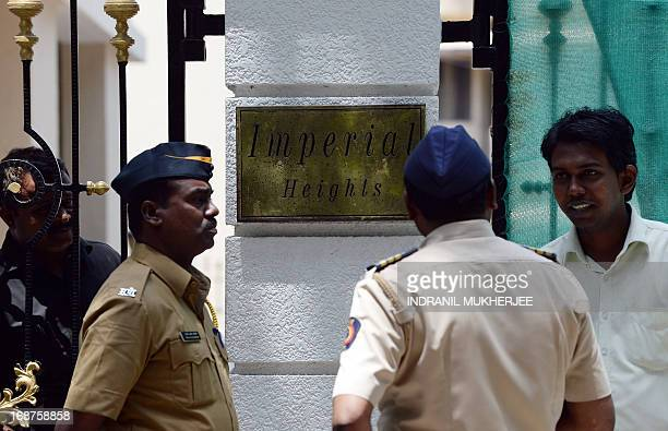 Indian policemen are seen outside the entrance gate to the residence of Bollywood actor Sanjay Dutt in Mumbai on May 15 2013 Bollywood star Sanjay...