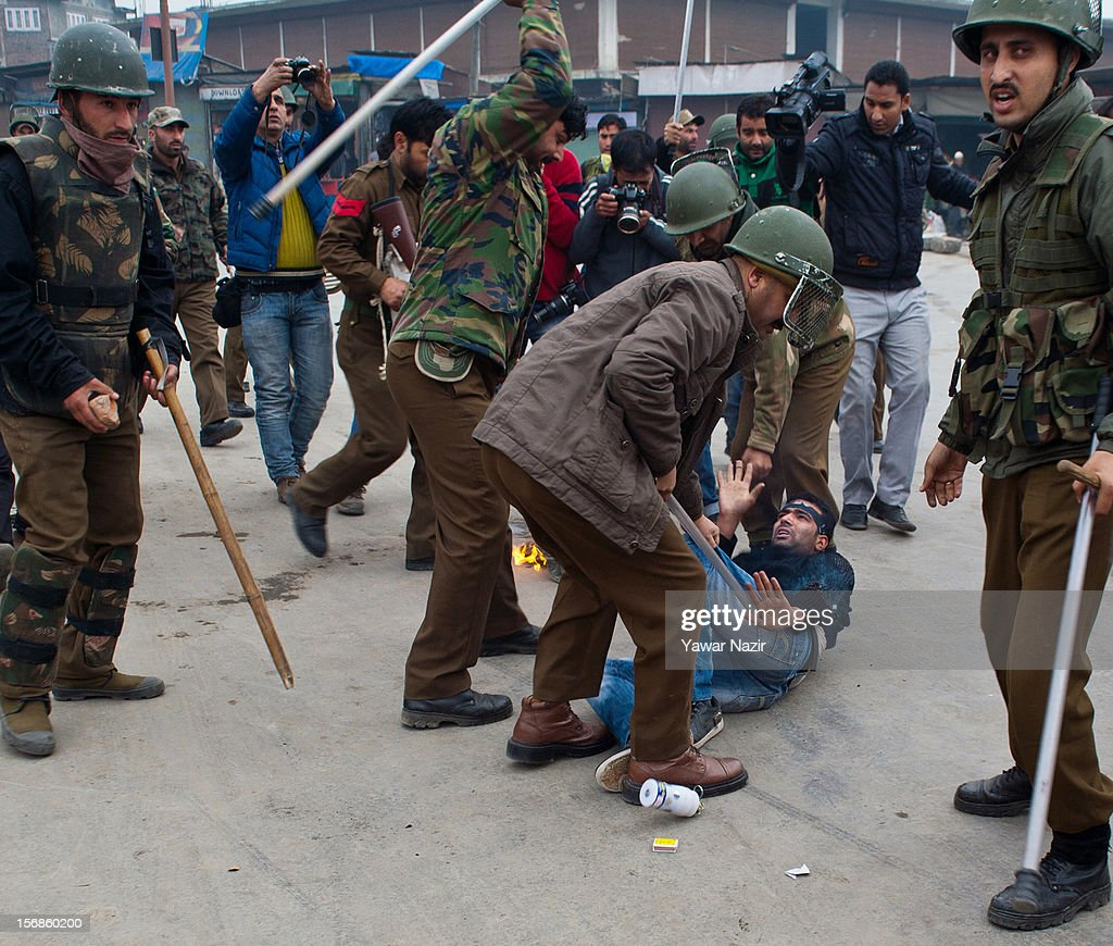 Indian policemen beat a Kashmiri Shiite mourner after he set himself on fire during a Muharram procession on November 23, 2012 in Srinagar, the summer capital of Indian administered Kashmir, India. Hundreds of Shiite Muslim mourners were detained by the Indian police as they tried to take part in the procession. Muslims all over the world mourn during Muharram, the first month of Islamic lunar calendar, the slaying of Imam Hussain, grandson of the Prophet Mohammed who was assassinated by his political rivals along with 72 companions in 680 AD in Iran. Shiite Muslims mourn by flagellating themselves with knives and swords. India has banned any processions and similar public gatherings in Kashmir after a rebellion against Indian rule broke out in 1989.