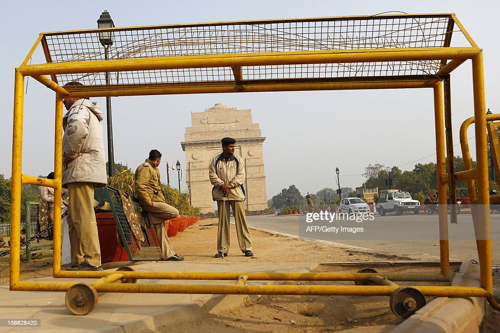 Indian policemen block a road leading to the India Gate Monument in New Delhi on December 31, 2012. The family of an Indian gang-rape victim said they would not rest until her killers are hanged as they spoke of their own pain and trauma over a crime that has united the country in grief.