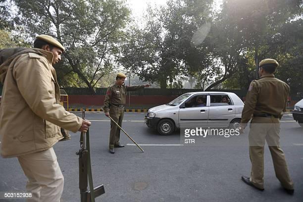 Indian policemen check a vehicle during a security check in New Delhi on January 2 following an attack on the Indian air force base in Pathankot A...