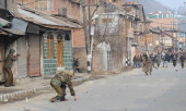 Indian policemen clash with Kashmiri demonstrators protesting against a military court verdict in downtown Srinagar on January 31 2014 Scores of...