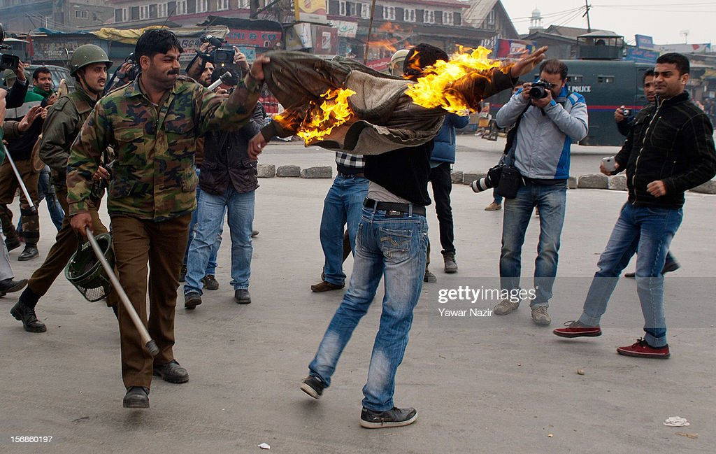 Indian policemen detain a Kashmiri Shiite mourner after he set himself on fire during a Muharram procession on November 23, 2012 in Srinagar, the summer capital of Indian administered Kashmir, India. Hundreds of Shiite Muslim mourners were detained by the Indian police as they tried to take part in the procession. Muslims all over the world mourn during Muharram, the first month of Islamic lunar calendar, the slaying of Imam Hussain, grandson of the Prophet Mohammed who was assassinated by his political rivals along with 72 companions in 680 AD in Iran. Shiite Muslims mourn by flagellating themselves with knives and swords. India has banned any processions and similar public gatherings in Kashmir after a rebellion against Indian rule broke out in 1989.