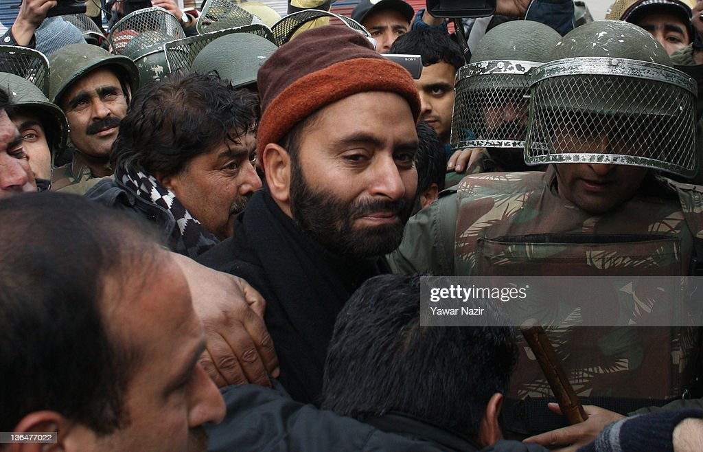 Indian policemen detain the Chairman of pro-independence Jammu and Kashmir Liberation Front (JKLF) <a gi-track='captionPersonalityLinkClicked' href=/galleries/search?phrase=Yasin+Malik&family=editorial&specificpeople=691200 ng-click='$event.stopPropagation()'>Yasin Malik</a> during a protest against the killing of a youth by Indian Central Industrial Security Force (CISF) on January 06, 2012 in Srinagar, the summer capital of Indian administered Kashmir, India. Altaf Ahmad Sood, an 18-year-old student, was killed and another person injured when CISF personnel fired shots during a protest against frequent power cuts in Boniyar, Uri, west of Srinagar, on Monday.