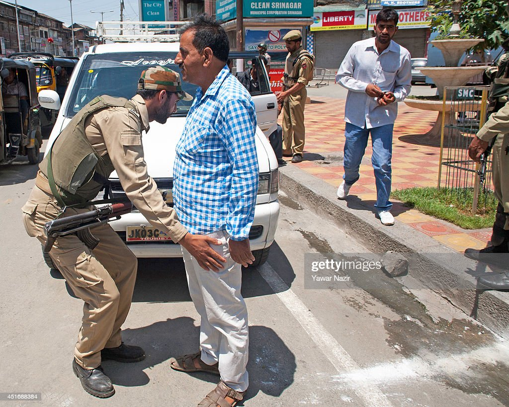 Indian policemen frisk a Kashmiri Muslim in the city centre during a strike against Indian Prime Minister Narendra Modi's visit on July 4, 2014, in Srinagar,the summer capital of Indian administered Kashmir, India. India's newly elected leader, Prime Minister Narendra Modi made his first official trip to Indian-controlled Kashmir, India's only Muslim-majority state, where separatist groups called a strike that closed down shops, businesses, schools, and all traffic. Disputes arose from Prime Minister Narendra Modi's inauguration of a railway line and a plan to review security and development in the Himalayan region dividing India and Pakistan. Reports stated that the restrictions were imposed to prevent any violent protests by separatist groups who oppose Indian rule.