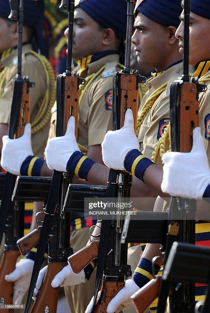 Indian policemen hold their rifles during a guard of honour at a memorial for those police and uniformed personnel who lost their lives in 2008 terror attacks in Mumbai on November 26, 2012.Pakistani-born Mohammed Ajmal Kasab, 25, the sole terrorist captured alive during the attack was hanged last week at a prison in western India for his role in what is India's deadliest terror attacks till date. A total of 166 people were killed and more than 300 others were injured when 10 heavily-armed Islamist militants stormed the city on November 26, 2008, attacking a number of sites, including the city's main railway station, two luxury hotels, a popular tourist restaurant and a Jewish centre.