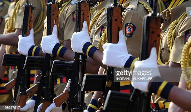Indian policemen hold their rifles during a guard of honour at a memorial for those police and uniformed personnel who lost their lives in 2008...