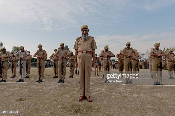 Indian policemen honour a killed police officer during the wreath laying ceremony of of their killed police officer on October 7 2015 in Srinagar the...