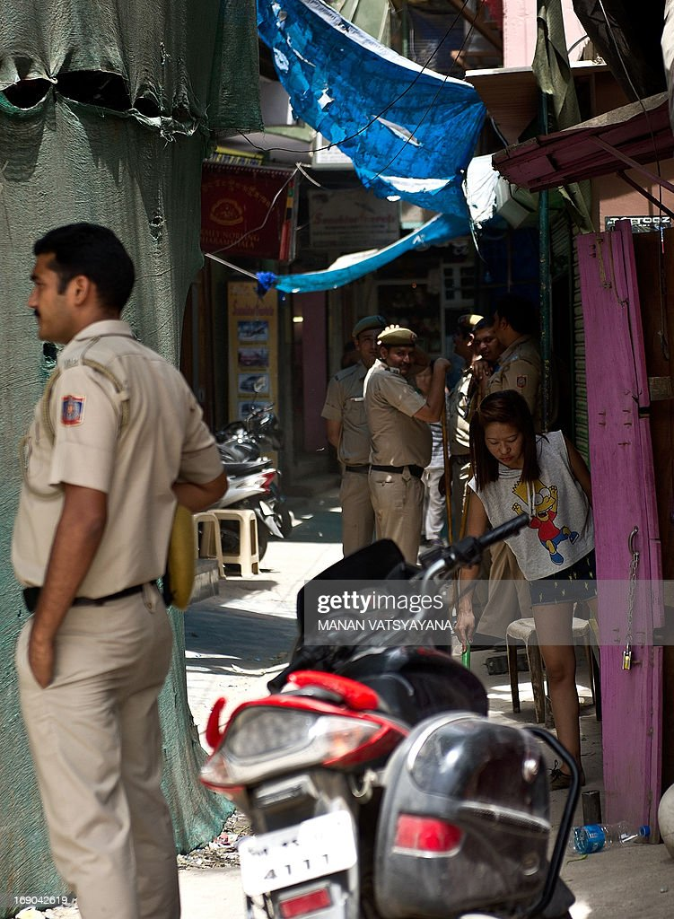 Indian policemen keep watch at the Tibetan refugee colony of Majnu Ka Tilla in New Delhi on May 19, 2013. Chinese Premier Li Keqiang arrived in India Sunday afternoon on the first stop of his maiden foreign trip, for talks on issues ranging from an unresolved border dispute to a festering trade-imbalance.