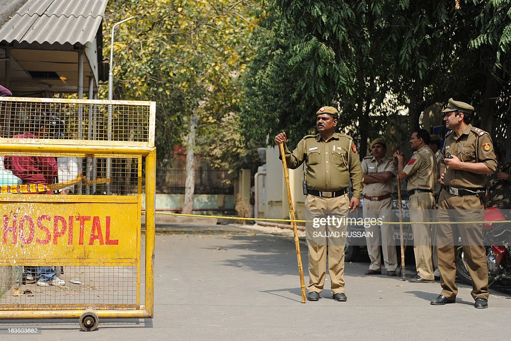 Indian policemen keep watch outside the Deen Diyal Upadhyay hospital mortuary, after the main accused of a fatal gang-rape case was found dead in his prison cell, in New Delhi on March 11, 2013. The main accused in the fatal gang-rape of a student on a bus in New Delhi last December was found dead in his prison cell March 11, prompting fury from the victim's family and accusations of murder.