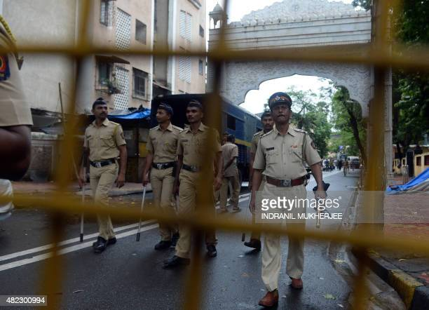 Indian policemen patrol a road leading to the residence of Yakub Memon a key plotter of the Mumbai bomb attacks which killed hundreds of people in...