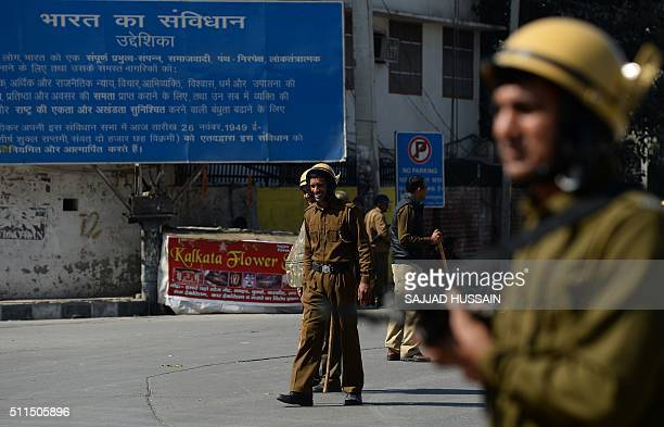 Indian policemen patrol along a street following violent caste protests in Rohtak on February 21 2016 Ten people have died in caste protests which...