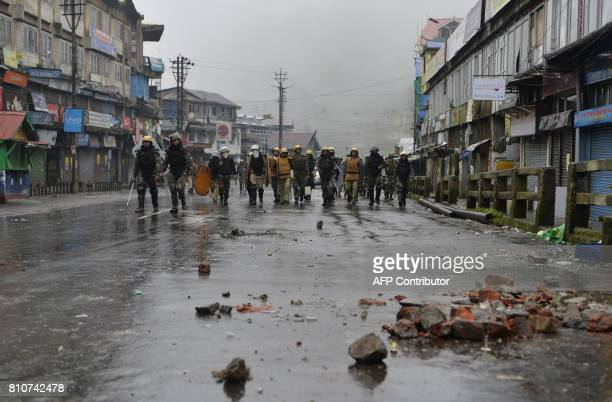 Indian policemen patrol along a streets following a clashes following clashes with Gorkhaland supporters during an indefinite strike called by Gorkha...