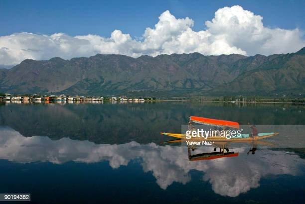 Indian policemen patrol Dal Lake in a shikara on August 31 2009 in Srinagar in Indian Administered Kashmir Kashmir is known for its charming beauty...