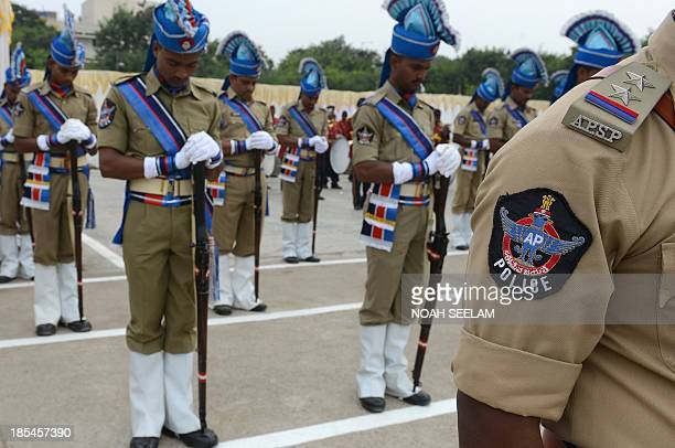 Indian policemen pay homage during a parade to police martyrs on the occasion of National Police Commemoration Day in Hyderabad on October 21 2013...