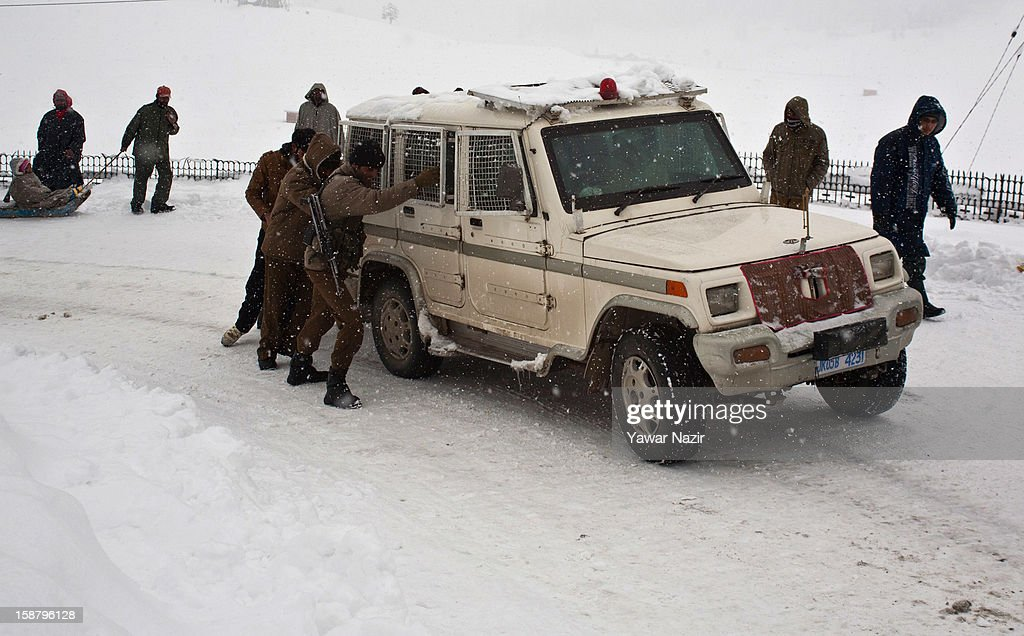 Indian policemen push their vehicle after it got stuck on a steep road during a snowfall on December 29, 2012 in Gulmarg, 54 km (35 miles) to the west of Srinagar, the summer capital of Indian-administered Kashmir, India. With the second round of heavy snowfall in Kashmir valley, skiers from around the globe have descended on the ski resort of Gulmarg, known for long-run skiing, snow-boarding, heli-skiing and steep mountains. Gulmarg is located less than six miles from the ceasefire line or Line of Control (LoC) that divides Kashmir between India and Pakistan. As a sense of normalcy has started to return to this strife-torn region, various foreign governments, including the United Kingdom, have lifted the travel advisory to its citizens traveling to Kashmir, raising the hopes of the local tourism industry, officials said.