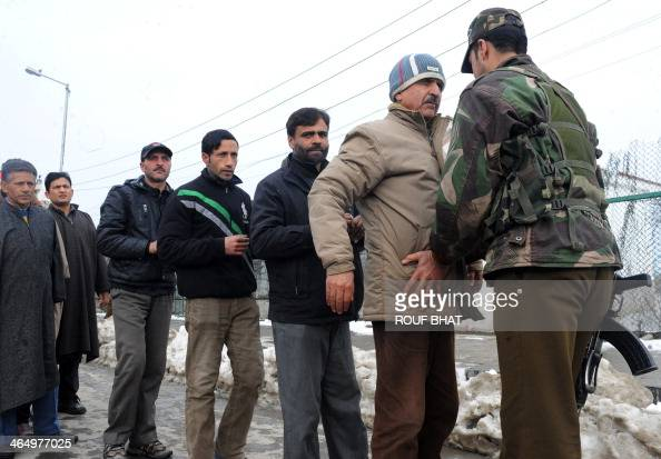 Indian policemen search Kashmiri pedestrians near the venue for Republic Day celebrations in Srinagar on January 25 2014 Security has been increased...