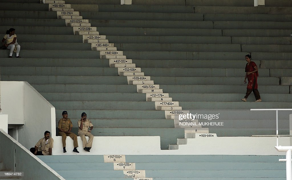 Indian policemen sit in the empty stands during the inugural match of the ICC Women's World Cup 2013 between India and West Indies at the Cricket Club of India's Brabourne stadium in Mumbai on January 31, 2013. Teams from Australia, England, New Zealand, Pakistan, South Africa, Sri Lanka, West Indies join hosts India for the global event which is being played from 31 January to 17 February. The women's World Cup opened in Mumbai with the cricketers hoping to put aside memories of the unsavoury build-up and gain their due recognition in a country where the men's game reigns supreme. AFP PHOTO/ Indranil MUKHERJEE