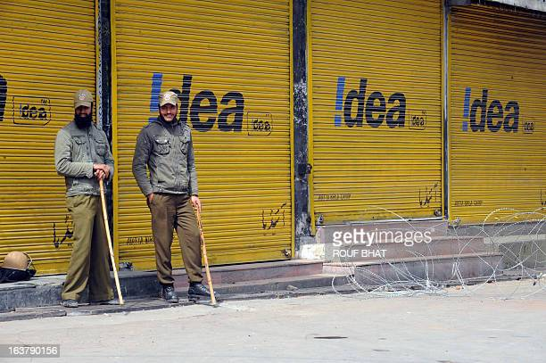 Indian policemen stand guard during the third day of a curfew imposed on the Kashmiri summer capital in Srinagar on March 16 2013 Restrictions have...