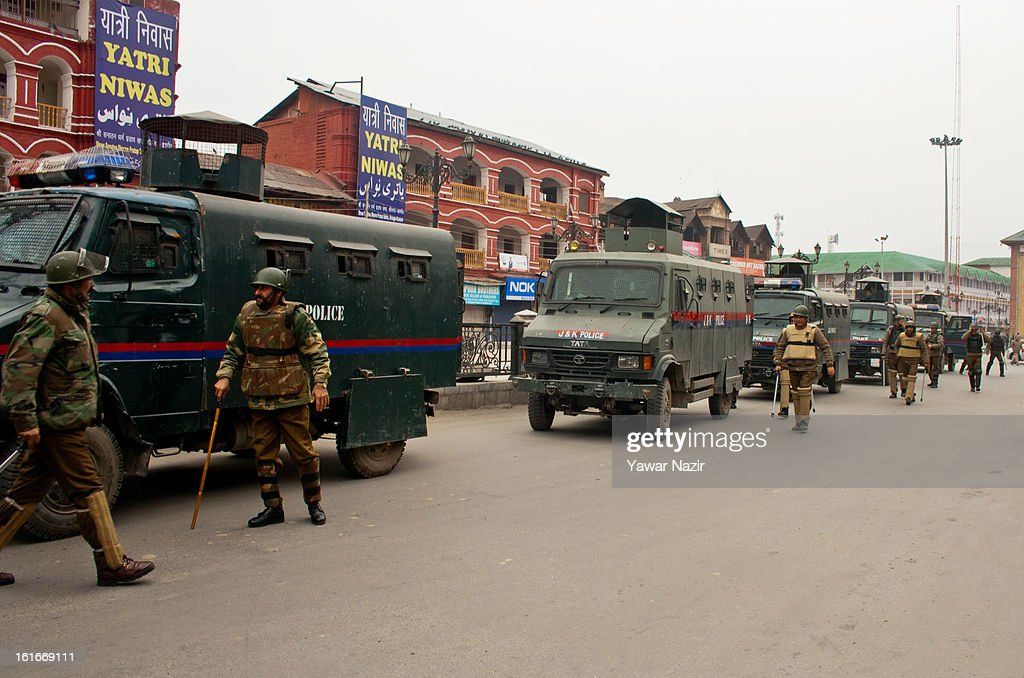 Indian policemen stand guard in the city centre during a relaxation in curfew, imposed after the execution of alleged Indian parliament attacker Mohammad Afzal Guru on February 14, 2013 in Srinagar, the summer capital of Indian Administered Kashmir, India. Afzal Guru, from Sopore town in the north of Kashmir, was hung on February 9 for his role in the 2001 Indian parliament attack which left 14 dead. The hanging has further strained relations between India, who blamed the attack on 'Pakistan backed' militant group Jaish-e-Mohammed and neighbouring Pakistan and has seen a military increase from both along the border.