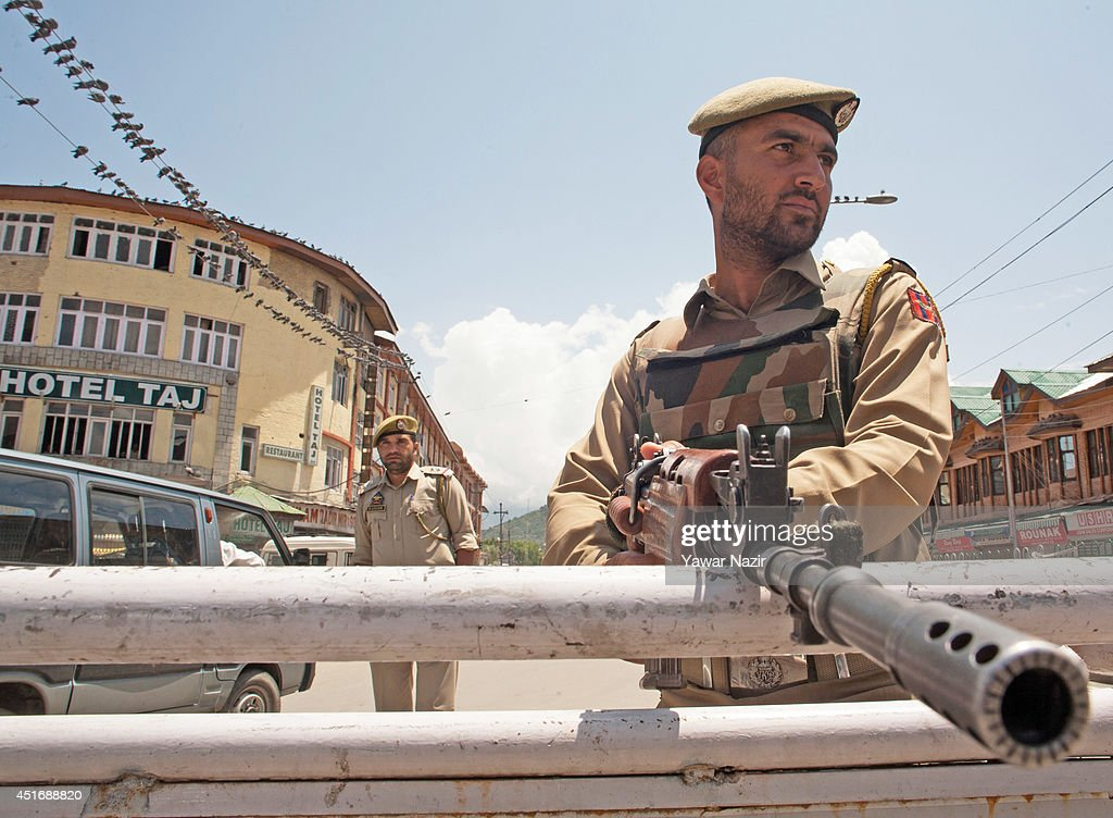 Indian policemen stand guard in the city centre during a strike against Indian Prime Minister Narendra Modi's visit on July 4, 2014, in Srinagar,the summer capital of Indian administered Kashmir, India. India's newly elected leader, Prime Minister Narendra Modi made his first official trip to Indian-controlled Kashmir, India's only Muslim-majority state, where separatist groups called a strike that closed down shops, businesses, schools, and all traffic. Disputes arose from Prime Minister Narendra Modi's inauguration of a railway line and a plan to review security and development in the Himalayan region dividing India and Pakistan. Reports stated that the restrictions were imposed to prevent any violent protests by separatist groups who oppose Indian rule.