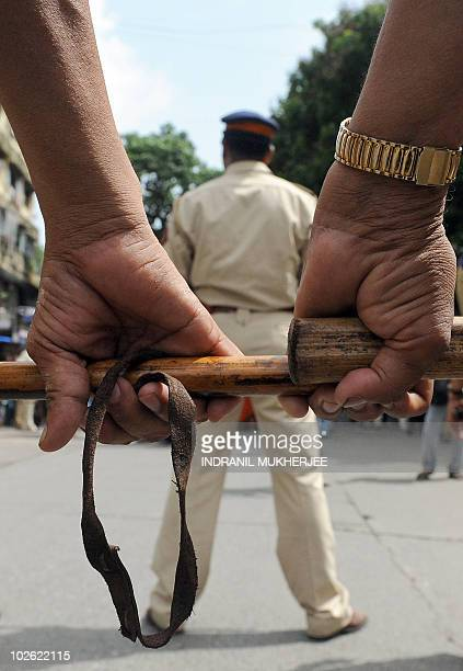 Indian policemen stand guard outside a city railway station during a strike in Mumbai on July 5 2010 Police came out in force in cities across India...