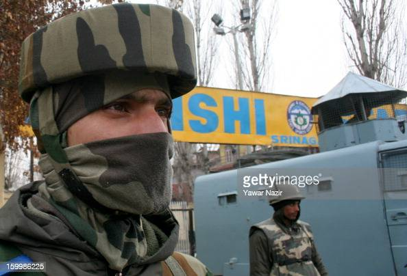 Indian policemen stand guard outside the Bakshi stadium where the authorities hold the main function on January 26 to mark India's Republic Day on...