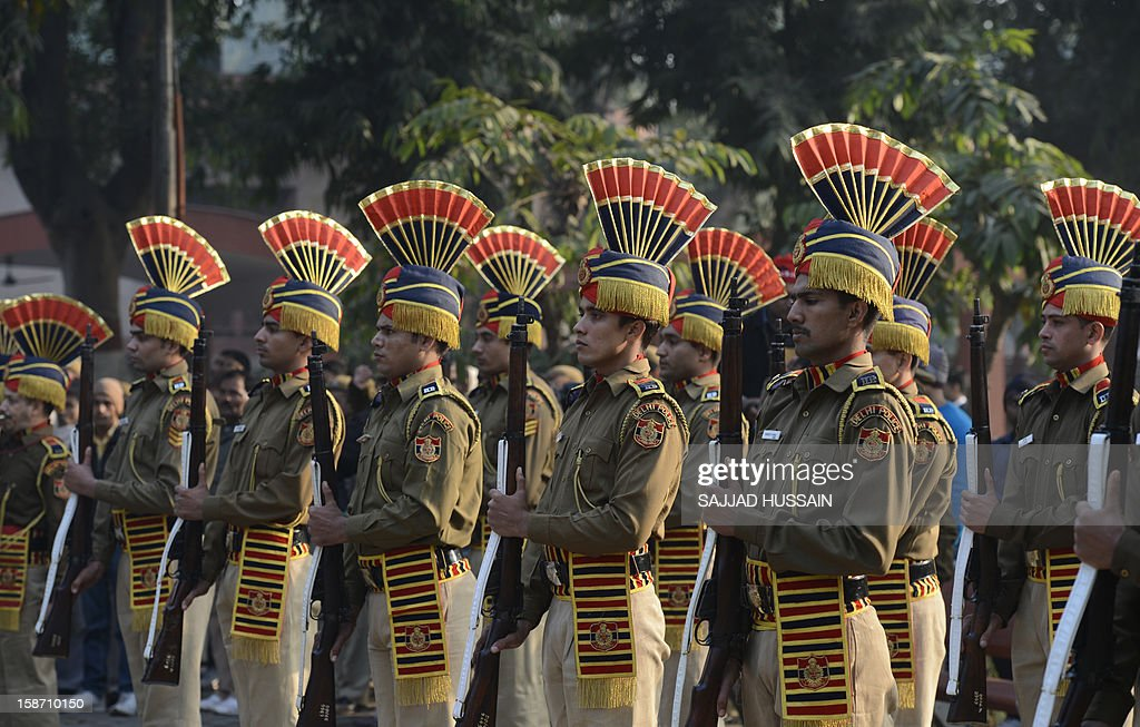 Indian policemen stand in formation as they pay their last respects for their fallen comrade Subash Tomar during his funeral in New Delhi on December 25, 2012. Tomar, a 47-year-old constable Indian policeman who was injured in clashes during a protest over a gang-rape in New Delhi has died. Tomar, a 47-year-old constable deployed at the India Gate monument on December 23 to control the protests, was beaten up by a mob and rushed to hospital by the police.