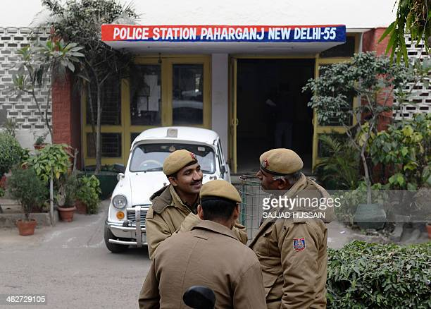 Indian policemen stand in front of the Paharganj police station in New Delhi on January 15 2013 one day after a Danish tourist visiting India was...
