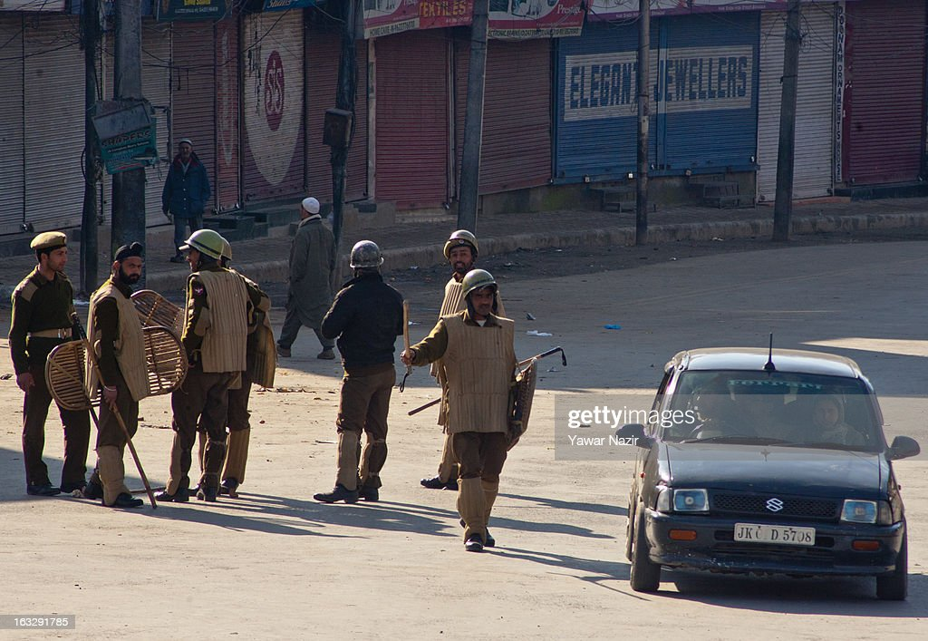 Indian policemen stop a car during a curfew-like restriction on March 7, 2013 in Srinagar, the summer capital of Indian Administered Kashmir, India. Clashes erupted in most parts of Kashmir today leaving scores of people injured. Meanwhile Indian authorities imposed curfew-like restrictions for the second consecutive day in most parts of Kashmir following the killing of a Kashmiri youth by the Indian army in North Kashmir's Baramulla district.