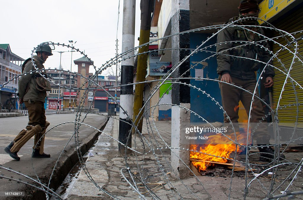 Indian policemen warm themselves on a roadside in city centre during a strict curfew on the seventh consecutive day, imposed after the execution of alleged Indian parliament attacker Mohammad Afzal Guru on February 15, 2013 in Srinagar, the summer capital of Indian Administered Kashmir, India. Afzal Guru, from Sopore town in the north of Kashmir, was hung on February 09 for his role in the 2001 Indian parliament attack which left 14 dead. The hanging has further strained relations between India - who blamed the attack on 'Pakistan backed' militant group Jaish-e-Mohammed - and neighbouring Pakistan and has seen an military increase from both along the border.Curfew was lifted from some parts of Srinagar after four days.