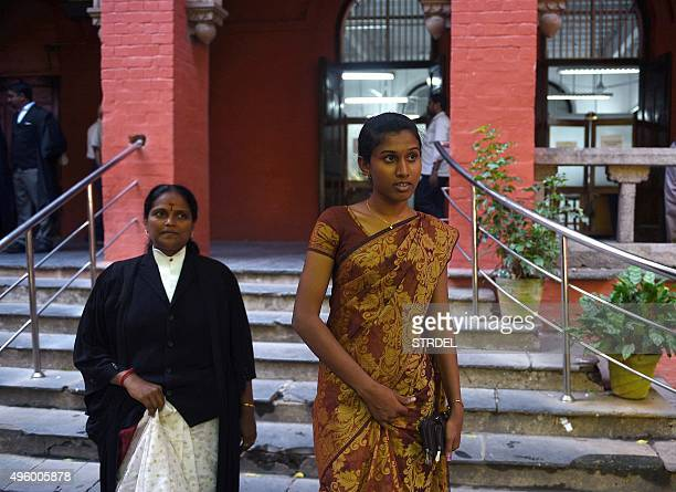 Indian policewoman K Prithika Yashini leaves with her lawyer after a judgement cleared legal hurdles allowing her to become India's first transgender...