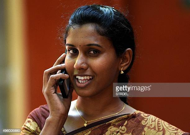 Indian policewoman K Prithika Yashini speaks on the phone as she leaves after a judgement cleared legal hurdles allowing her to become India's first...