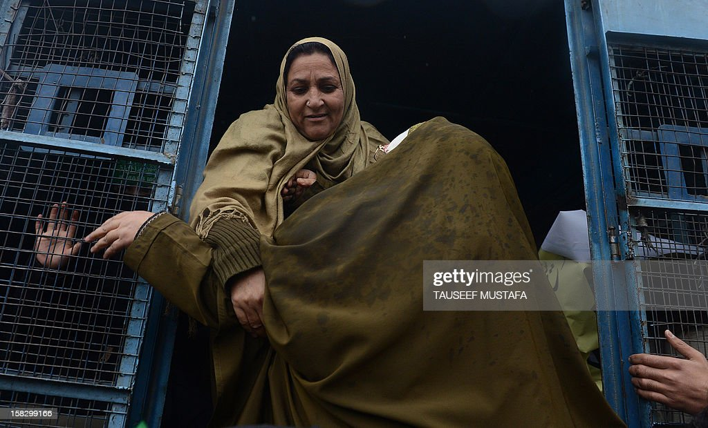 Indian policewomen detain an activist of the Jammu and Kashmir Mass Movement (JKMM) during a protest in support of clemency for Mohammad Afzal Guru in Srinagar on December 13, 2012. Indian police detained some half a dozen activists during the protest. Fellow Kashmiri, Mohammad Afzal Guru was sentenced to death by an Indian court after being found guilty of being involved in the 13 September 2001 attack on India's Parliament House in New Delhi. The protestors appealed to the President to commute the death sentence of Guru and reinvestigate the case. AFP PHOTO/Tauseef MUSTAFA