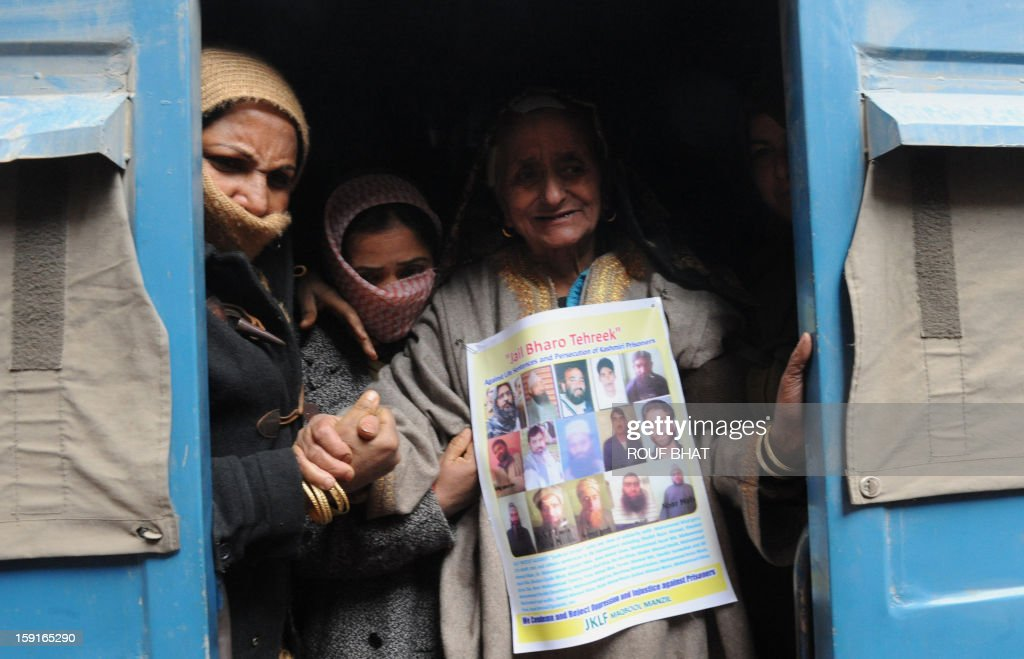 Indian policewomen detain the mother of Maqbool Bhat during during a 'jail bharo' agitation organised by pro-independence Jammu and Kashmir Libration Front (JKLF) to tempt police for their arrest, in Srinagar on January 9, 2013. The agitation was held to protest against the life sentences to Kashmiri prisoners by the Indian courts. At least 29 Kashmiri men are in jails serving life sentences, according to Kashmiri human rights group. AFP PHOTO/Rouf BHAT