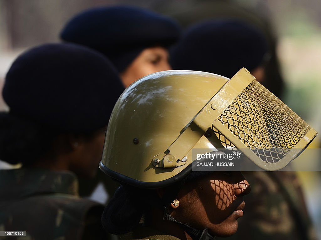 Indian policewomen in riot gear stand watch at Jantar Mantar following weekend clashes between demonstrators and police in New Delhi on December 25, 2012. A 47-year-old constable Indian policeman who was injured in clashes during a protest over a gang-rape in New Delhi has died. Subash Tomar, a 47-year-old constable deployed at the India Gate monument on December 23 to control the protests, was beaten up by a mob and rushed to hospital by the police. AFP PHOTO/SAJJAD HUSSAIN