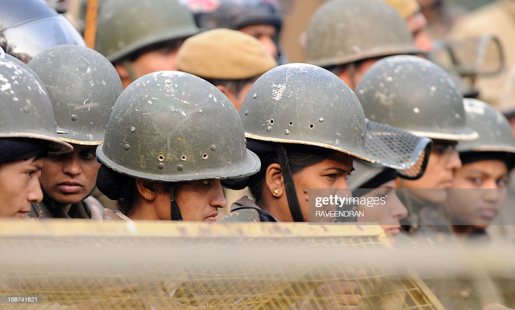 Indian policewomen stand alert behind a barricade during a protest calling for better safety for women following the rape of a student in the Indian capital, in New Delhi on December 27, 2012. Protests across India over the last week against sex crimes have denounced the police and government, with the largest in New Delhi at the weekend prompting officers to cordon off areas around government buildings. One policeman was killed and more than 100 people injured in the violence.