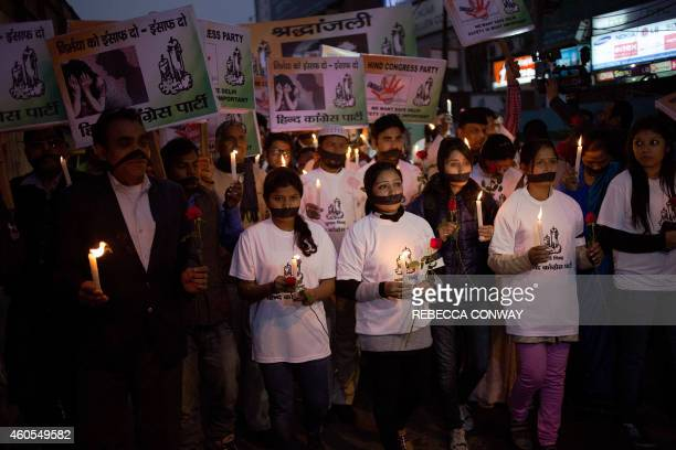 Indian political and civil society activists take part in a vigil to mark the second anniversary of the fatal gangrape of a student in the Indian...
