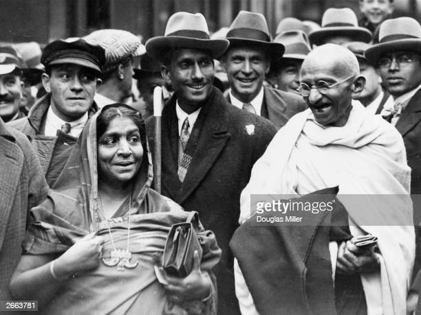 Indian political and spiritual leader Mahatma Gandhi at Boulogne station with Mrs Sarojini Naidu on the way to England to attend the Round Table...