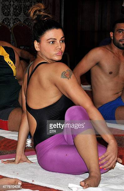 Indian politician and actress Rakhi Sawant takes part in a yoga session on International Yoga Day in Mumbai on June 21 2015 AFP PHOTO